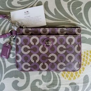 Coach NWOT Purple and Brown PVC Wristlet